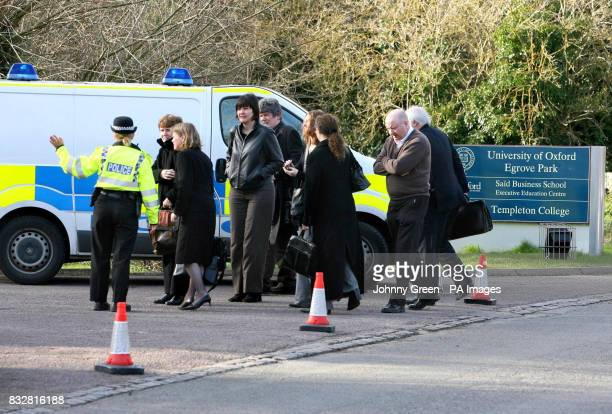 A Thames Valley Police officer allows conference delegates back inside the grounds of Templeton College in Kennington Oxfordshire after two...