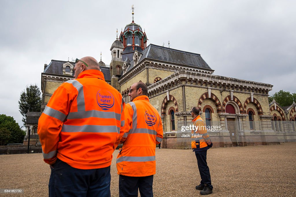 Thames Water employees stand outside The Abbey Mills pumping station in Stratford on May 25, 2016 in London, England. The Grade II listed building, designed by British engineer Joseph Bazalgette to lift sewage from the low-lying areas of north London, was completed in 1868. Thames Water marks Sewage Week this week with a series of events inviting members of the public down into the underground sewer network and around the Abbey Mills pumping station in east London.