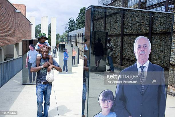 Thami Nkosi a 29year old activist visits the Apartheid museum with his son on January 17 in Johannesburg South AfricaThami is a gender justice...