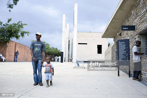 Thami Nkosi a 29year old activist visits the Apartheid museum with his son on January 17 in Johannesburg South Africa Thami is a gender justice...