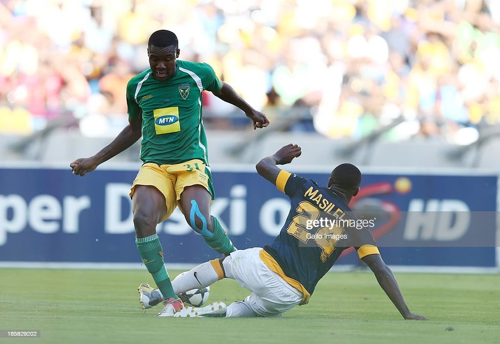 Thamsanqa Gabuza is tackled by Tsepo Masilela (R) during the Absa Premiership match between Golden Arrows and Kaizer Chiefs at Moses Mabhida Stadium on April 06, 2013 in Durban, South Africa.