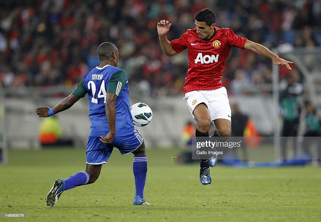 Thamsanqa Teyise and Frederico Macheda go for the ball during the MTN Football Invitational match between Amazulu and Manchester United from Moses Mabhida Stadium on July 18, 2012 in Durban, South Africa