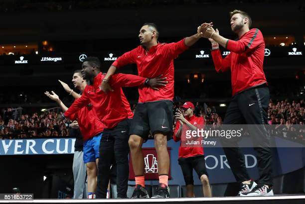 Thanasi Kokkinakis Frances Tiafoe Nick Kyrgios and Jack Sock of Team World react on the players bench as Denis Shapovalov of Team World plays his...