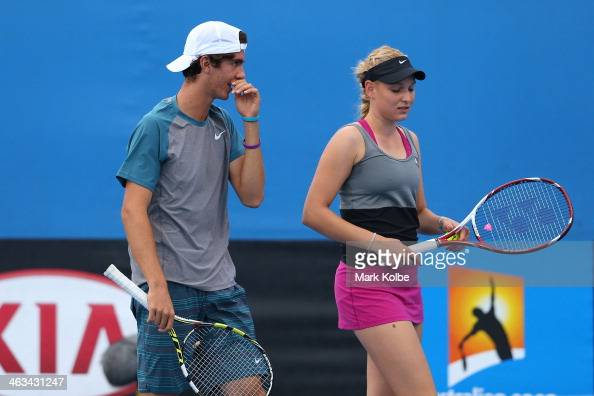 Thanasi Kokkinakis of Australia and Donna Vekic of Croatia in action in their first round mixed doubles match against Julia Goerges of Germany and...
