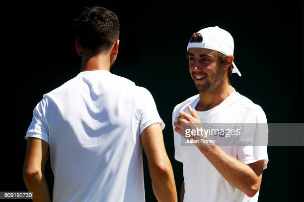 Thanasi Kokkinakis of Australia and partner Jordan Thompson of Australia in discussion during the Gentlemen's Doubles first round match against...
