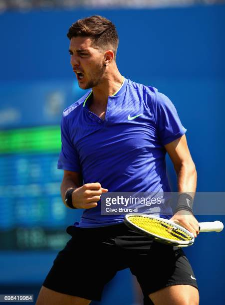 Thanasi Kokkinakis of Australia celebrates a point during mens singles first round match against Milos Raonic of Canada on day two of the 2017 Aegon...