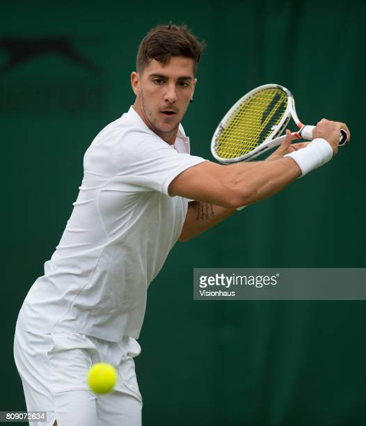 Thanasi Kokkinakis of Australia in action against Juan Martin Del Potro of Argentina on day two of the Wimbledon Lawn Tennis Championships at the All...