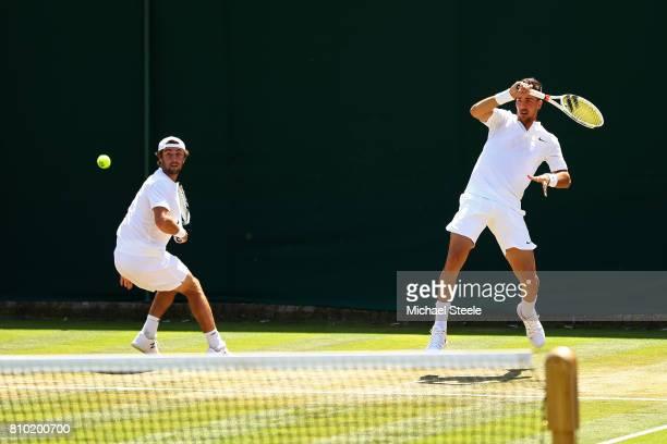 Thanasi Kokkinakis of Australia plays a forehand during the Gentlemen's Doubles second round match with Thanasi Kokkinakis of Jordan Thompson of...