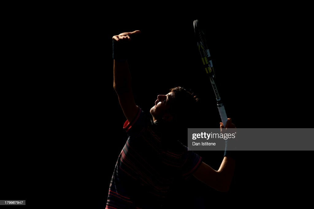 <a gi-track='captionPersonalityLinkClicked' href=/galleries/search?phrase=Thanasi+Kokkinakis&family=editorial&specificpeople=7449036 ng-click='$event.stopPropagation()'>Thanasi Kokkinakis</a> of Australia serves during the boys' singles semifinal match against Christian Garin of Chile on Day Thirteen of the 2013 US Open at USTA Billie Jean King National Tennis Center on September 7, 2013 in the Flushing neighborhood of the Queens borough of New York City.