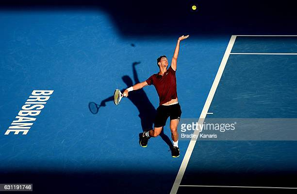 Thanasi Kokkinakis of Australia serves in his match with team mate Jordan Thompson of Australia against Gilles Muller of Luxembourg and Sam Querrey...