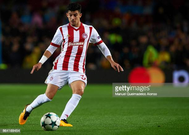 Thanasis Androutsos of Olympiakos in action during the UEFA Champions League group D match between FC Barcelona and Olympiakos Piraeus at Camp Nou on...