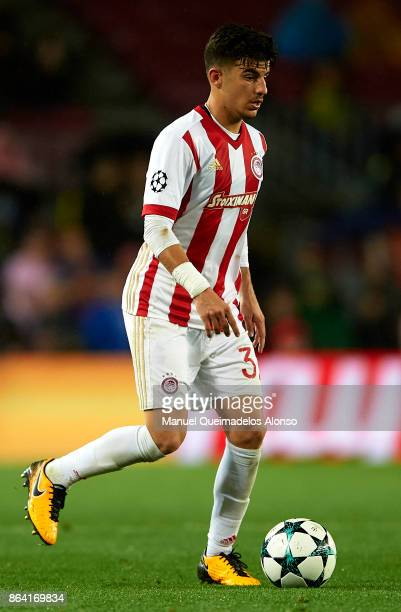 Thanasis Androutsos of Olympiakos runs with the ball during the UEFA Champions League group D match between FC Barcelona and Olympiakos Piraeus at...