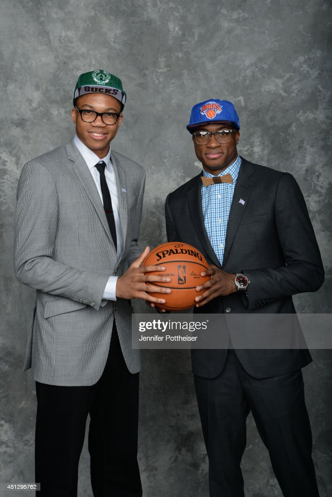 Thanasis Antetokounmpo and Giannis Antetokounmpo poses for a portrait with his brother during the 2014 NBA Draft at the Barclays Center on June 26...