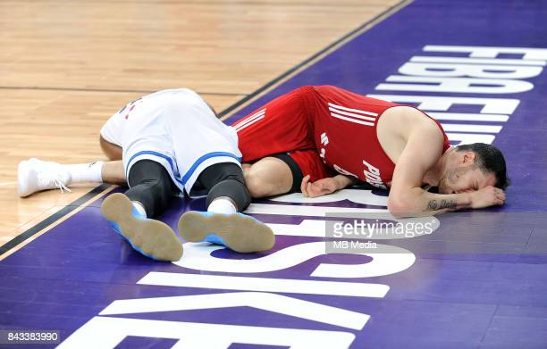 Thanasis Antetokounmpo of Greece Aaron Cel of Poland lie on the floor injured during the FIBA Eurobasket 2017 Group A match between Greece and Poland...