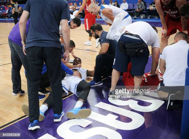 Thanasis Antetokounmpo of Greece Aaron Cel of Poland receive medical attention during the FIBA Eurobasket 2017 Group A match between Greece and...