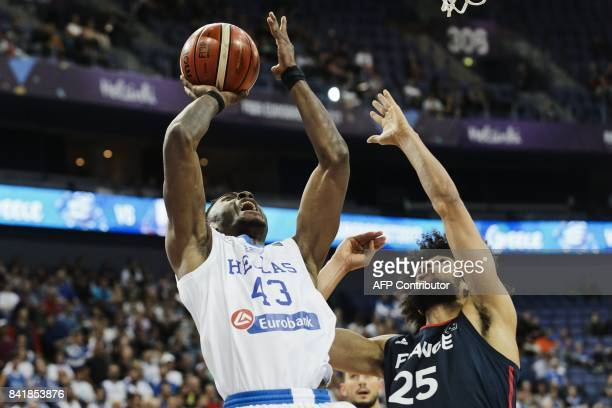 Thanasis Antetokounmpo of Greece throws over the defence by Louis Labeyrie of France during the 2017 FIBA Eurobasket mens Group A basketball match...