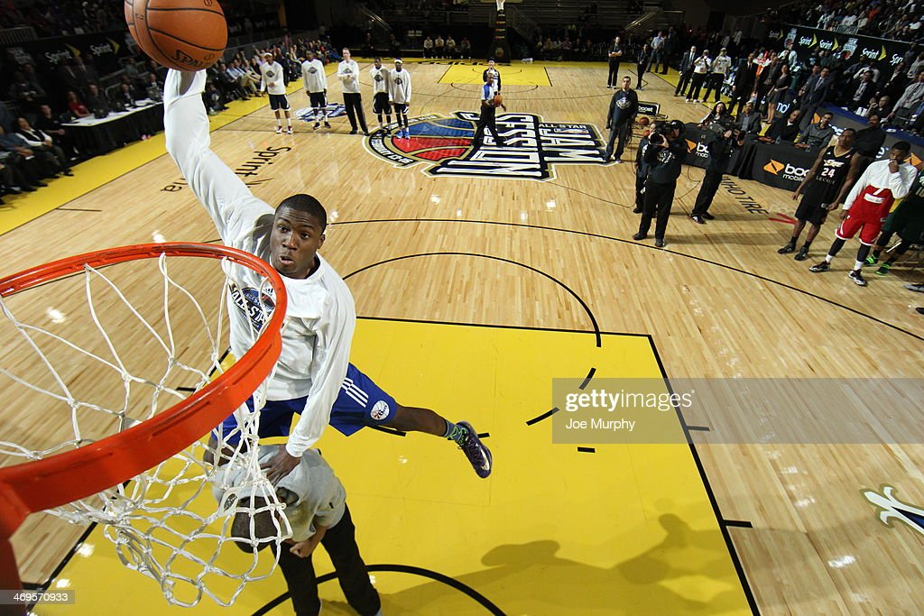 Thanasis Antetokounmpo #19 of the Deleware 87ers dunks over his brother, Giannis Antetokounmpo of the Milwaukee Bucks during the Slam Dunk Contest as part of the NBA Dream Factory presented by Boost Mobile 2014 at Sprint Arena as part of 2014 NBA All-Star Weekend at the Ernest N. Morial Convention Center on February 15, 2014 in New Orleans, Louisiana.