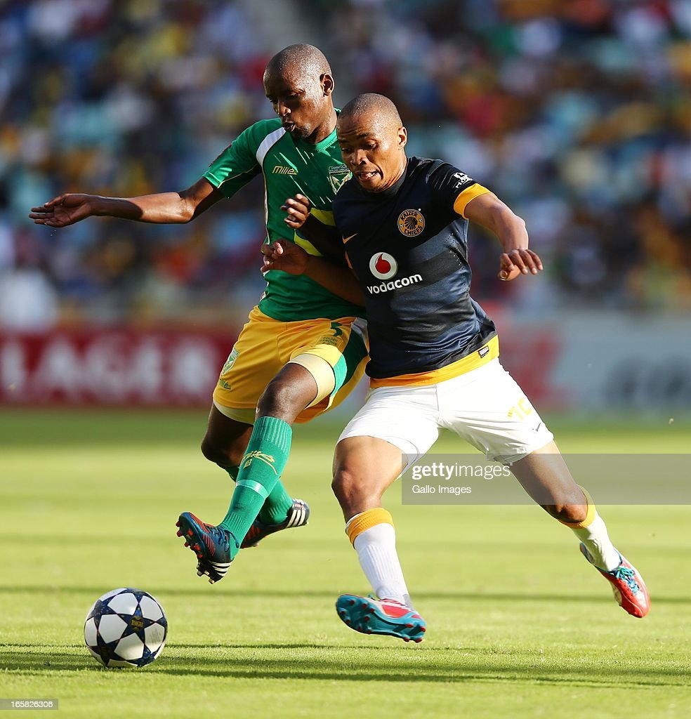 Thanduyise Khuboni (L) battles with Siyabonga Nkosi during the Absa Premiership match between Golden Arrows and Kaizer Chiefs at Moses Mabhida Stadium on April 06, 2013 in Durban, South Africa.