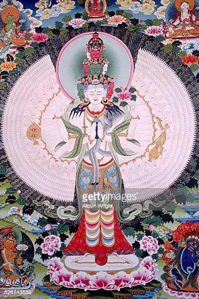 A Thangka painting depicting a central image of the Bodhisatva Avalokiteshvara