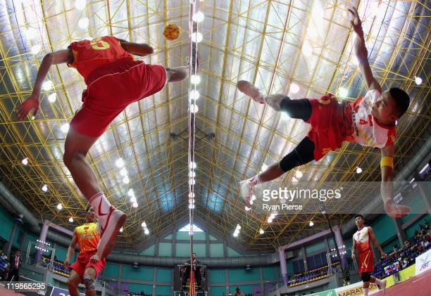 Thanh Man Chu of Vietnam kicks over the net against of Mao Hui Wang of China during the Round Robin match between Vietnam and China during day two of...
