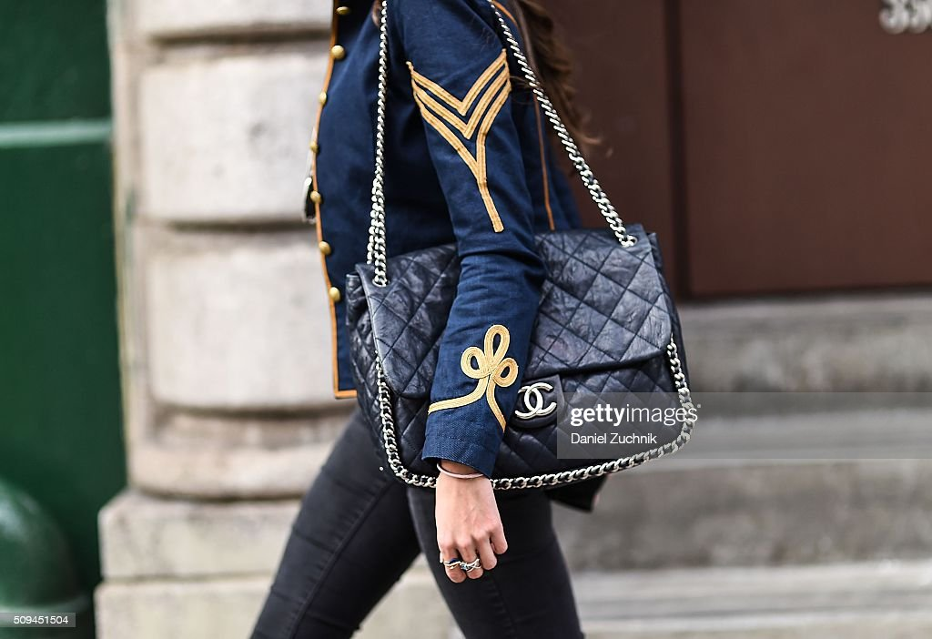 Thania Peck is seen on the streets of New York City wearing a Ralph Lauren blue and gold jacket Paige grey denim jeans and a Chanel blue leather bag...