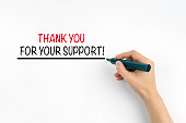 Hand with marker writing: Thank You For Your Support!