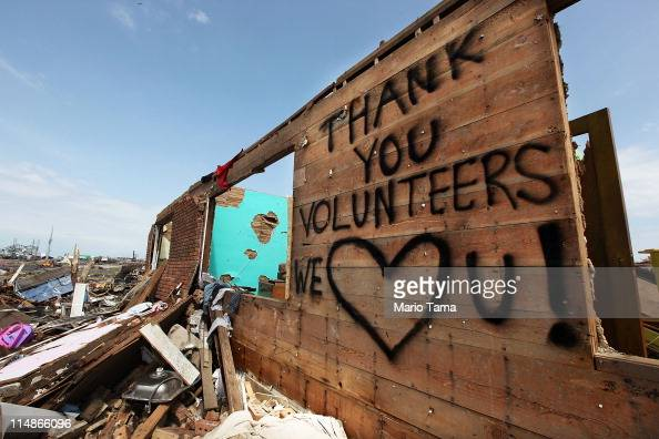 A thank you message to volunteers is seen onteh side of a building after a massive tornado passed through the town killing at least 132 people on May...