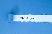 Thank you message written under blue torn paper.