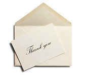 Thank you note against an open envelope isolated