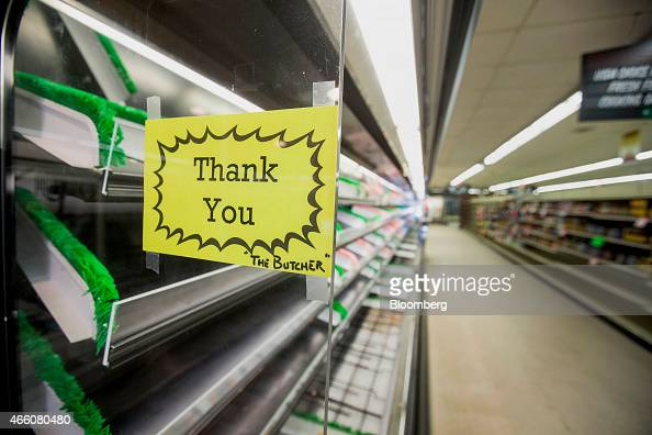 A thank you note from the butcher hangs on the side of a meat case at Colella's Supermarket in Hopkinton Massachusetts US on Saturday March 7 2015...