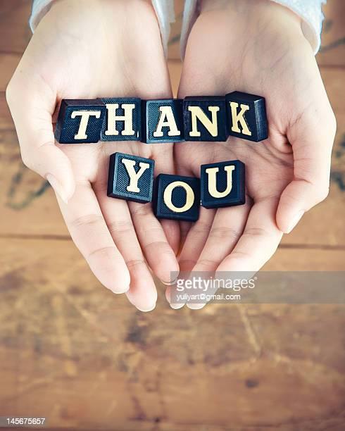 Thank you written in hands