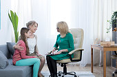 Loving mother and daughter thankful for therapist's help