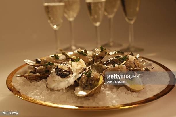 Thanksgiving Champagne story Warm oysters in their shells with leeks and champagne butter shot in the Los Angeles Times studio on November 12 2014