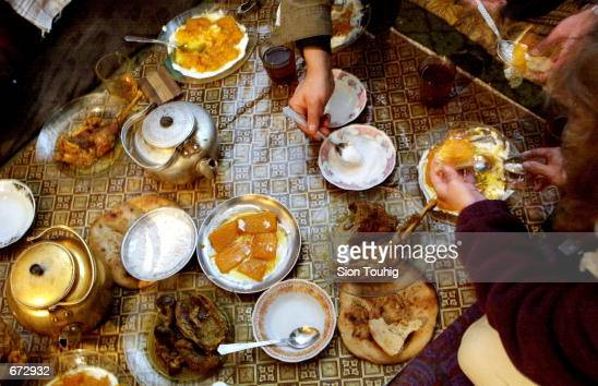 Thanksgiving dinner is served at Sufi Mumim's restaurant November 22 2001 in Talaquan Afghanistan Prepared dishes include roast turkey with pumpkin...