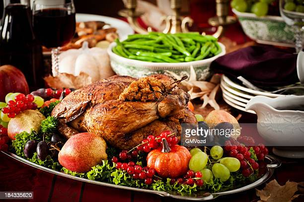 Thanksgiving Dinner with Stuffed Turkey and Side Dishes