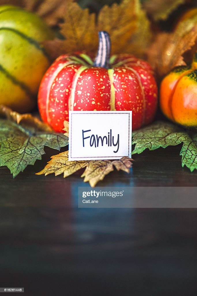 Thanksgiving fall arrangement with pumpkins, leaves and family message : Stock Photo