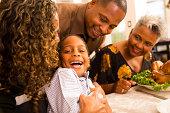 Thanksgiving: Family gathers for dinner at grandma's house.