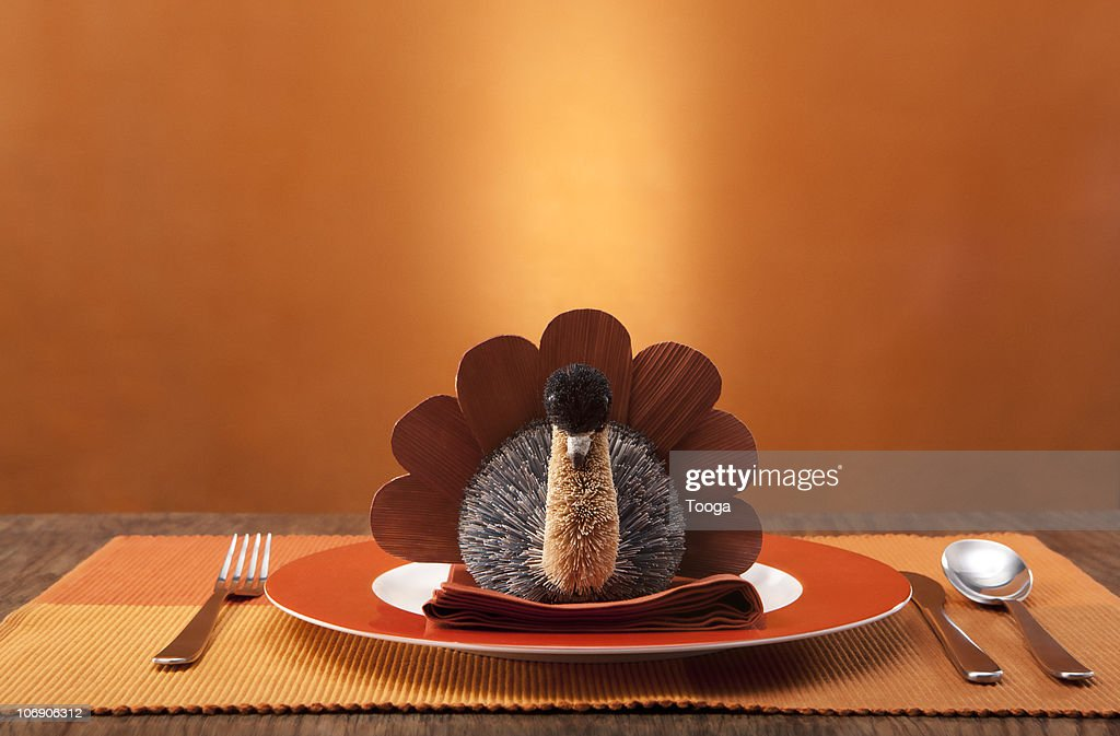 Thanksgiving place setting with small turkey : Stock Photo