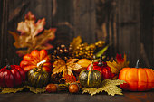 Thanksgiving still life background with pumpkins and acorns