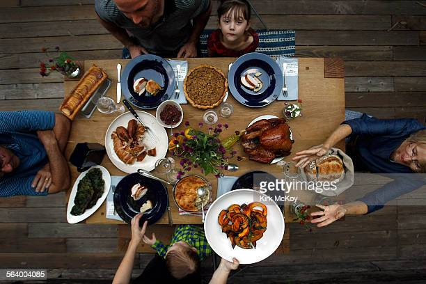Thanksgiving with chefs Karen and Quinn Hatfield children Bennett and Paige and inlaws Larry and Linda Friedman find their places at the table at...