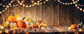 Thanksgiving Composition With String Lights And Vegetables