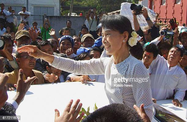 Thanlyin Myanmar Myanmar's prodemocracy icon Aung San Suu Kyi is surrounded by supporters at the Yangon South District Election Commission office in...
