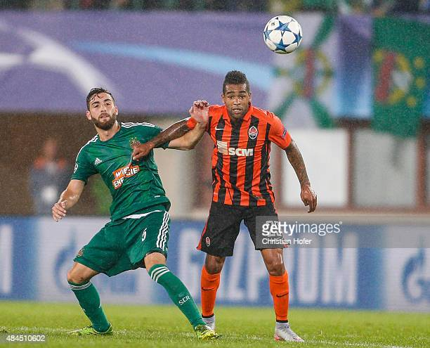 Thanos Petsos of Vienna competes for the ball with Alex Teixeira of Donetsk during the UEFA Champions League Qualifying Round Play Off First Leg...