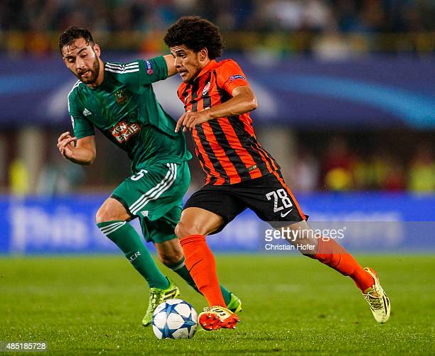 Thanos Petsos of Vienna competes for the ball with Taison of Donetsk during the UEFA Champions League Qualifying Round Play Off First Leg match...
