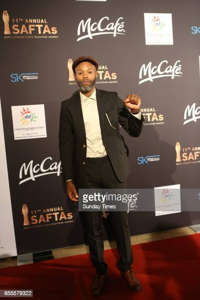 Thapelo Mokoena poses on the red carpet during the South African Film and Television Awards at Sun City on March 18 2017 in Rustenburg South Africa...