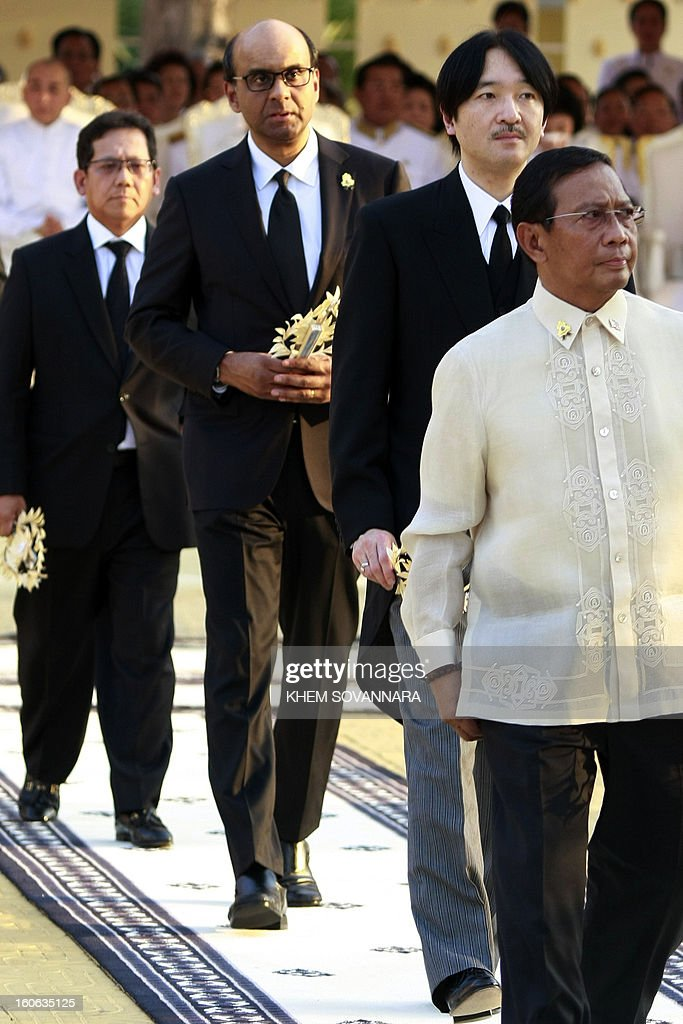 Tharman Shanmugaratnam (2nd L), Singapore's deputy prime minister and minister for finance, and Japanese Prince Akishino (2nd R) walk at the crematorium to pray of the late former King Norodom Sihanouk minutes before his cremation, near the Royal Palace in Phnom Penh on February 4, 2013. Thousands of mourners massed in the Cambodian capital as the kingdom cremated its revered former King Norodom Sihanouk, who steered his country through six turbulent decades.