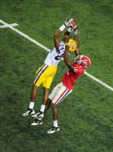 Tharold Simon of the LSU Tigers intercepts a pass against Tavarres King of the Georgia Bulldogs during the SEC Championship Game at the Georgia Dome...