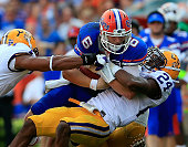 Tharold Simon of the LSU Tigers tackles Jeff Driskel of the Florida Gators during the game at Ben Hill Griffin Stadium on October 6 2012 in...