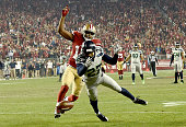 Tharold Simon of the Seattle Seahawks breaks up this pass to Michael Crabtree of the San Francisco 49ers at Levi's Stadium on November 27 2014 in...