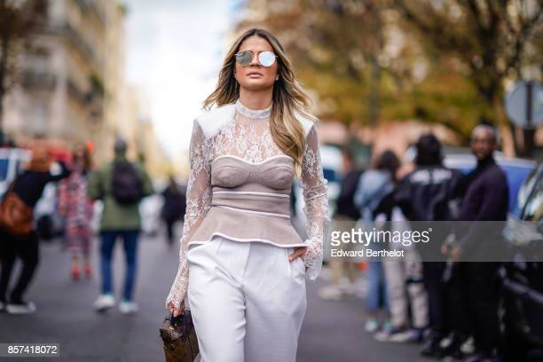 Thassia Naves outside Moncler during Paris Fashion Week Womenswear Spring/Summer 2018 on October 3 2017 in Paris France